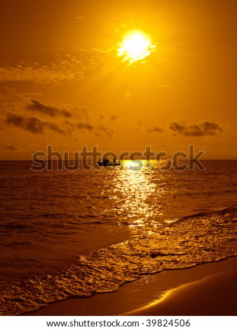 stock photo : Fish boat at sunset in a beach of Fuerteventura