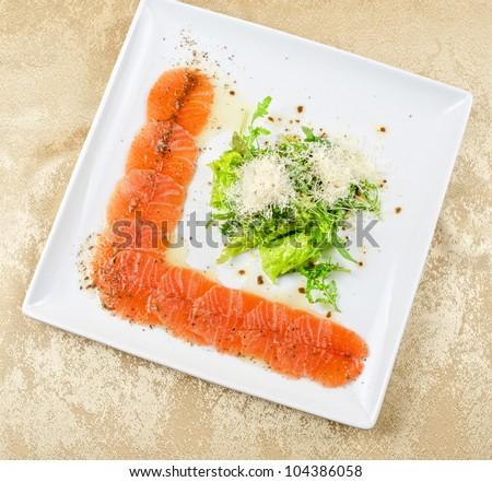 Fish Carpaccio with salad and mozzarella