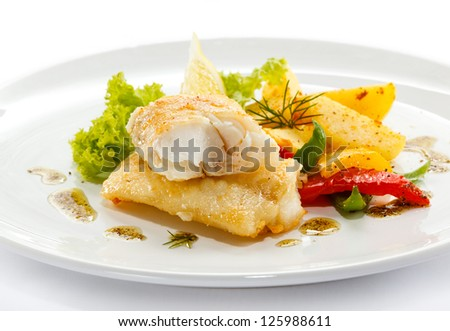 Fish dish - fried fish, fried potatoes and vegetables