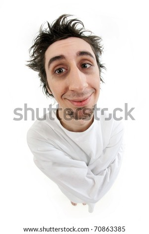 Fish eye shot of insane man in strait-jacket smiling in isolation