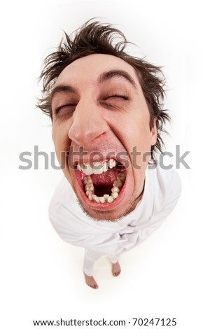 Fish eye shot of screaming insane man in strait-jacket in isolation