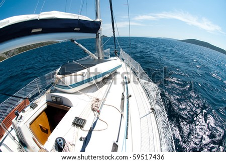 fish-eye view of a yacht on a blue sea