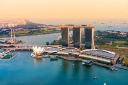 Fish-eye view of Singapore city skyline at sunset.