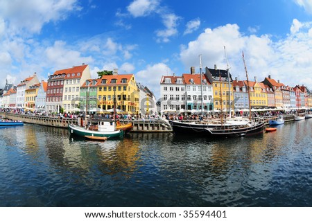 Fish eye view on colorful houses and boats in famous canal Nyhavn in Copenhagen, Denmark