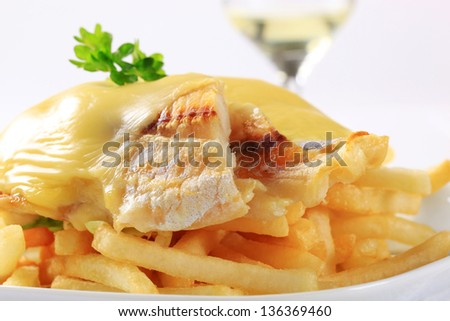 fish fillet with melted cheese and french fries