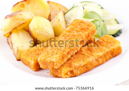 Fish fingers with potato - stock photo