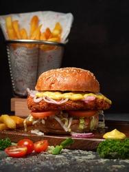 Fish fried burger on dark background.