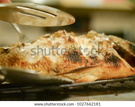 Fish grilled served and served with vegetables in the restaurant. #1027662181