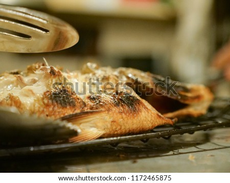 Fish grilled served and served with vegetables in the restaurant. #1172465875