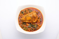 Fish head curry,Rohu fish head curry in south indian style arranged in a white ceramic bowl,isolated on white background.
