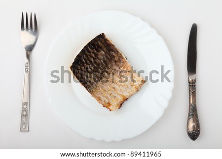 Fish in plate.