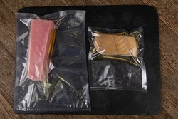 Fish in vacuum sealed packaging placed on a slate