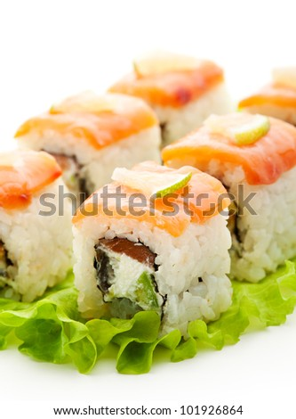 Fish Maki Sushi - Roll with Salmon, Eel and Avocado inside. Topped with Smoked Salmon and Lime