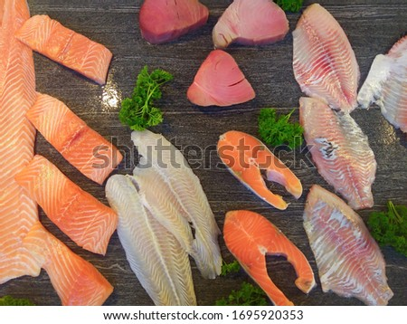 Fish market/Fresh fish on ice. Salmon Fish. Fresh seafood on ice. Octopus and Red fish ready to buy. Seafood market/Seafood variety. Show-window of seafood in the sea market. Delivery order concept.