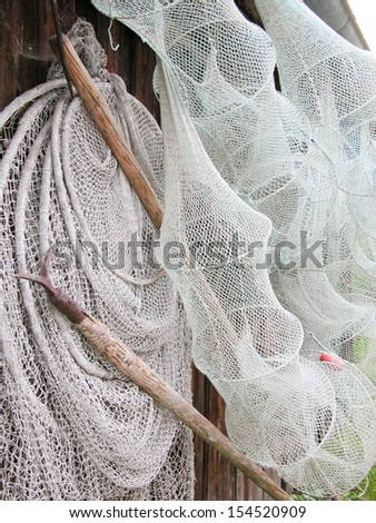 Fish Nets and Pike Poles Hanging on a Hut Wall