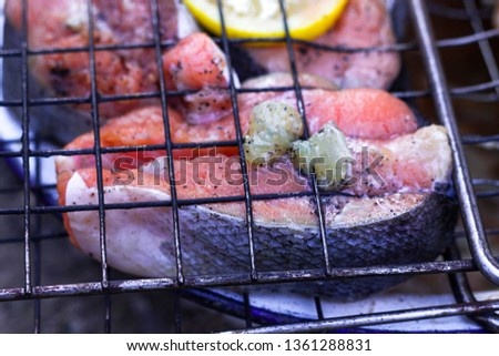 fish on the grill in the grill. grill season. salmon on fire #1361288831