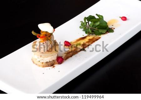 Fish rillettes amuse bouche with pomegranate and fresh basil