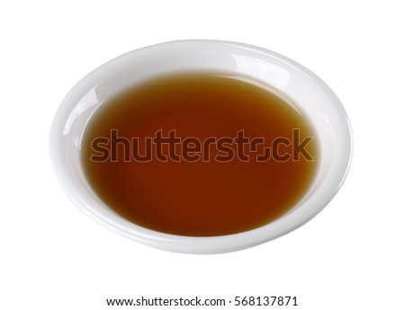 Fish sauce in white bowl isolated on background