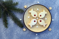 Fish shaped linzer cookies filled with strawberry jam, with romantic festive Christmas decoration