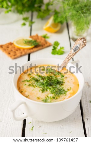 Fish soup from salmon, potato and cream - stock photo