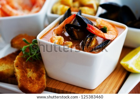 Fish soup - traditional Mediterranean fish soup with mussels and shrimp