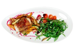 Fish steak with vegetable ratatoille and rocket salad, isolated on white