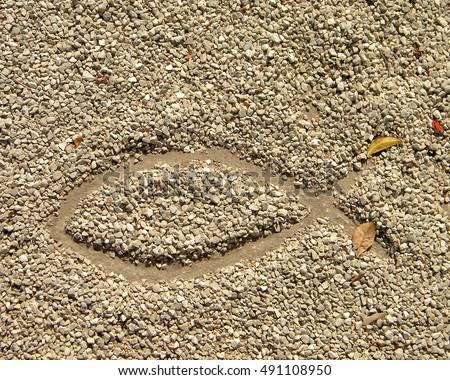 Fish symbol in drawn in the sand in Israel desert #491108950