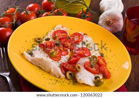 Fish with cherry tomatoes and olive.