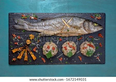 Fish with mushroom rizotto black Stock fotó ©