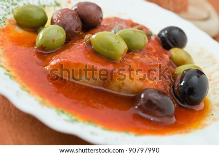 Fish with olives in tomato sauce.