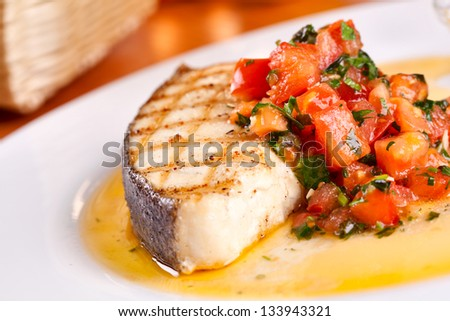 Fish with tomato - stock photo