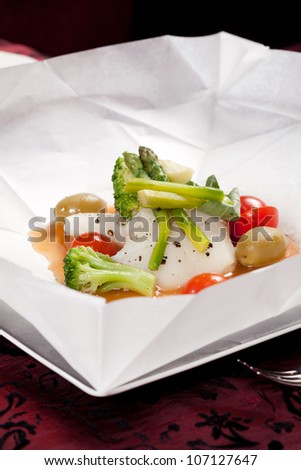 fish with vegetables in the parchment