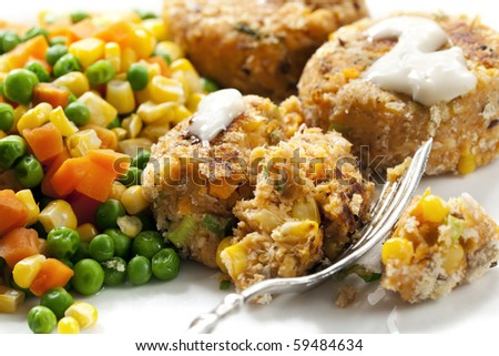 Fishcakes with vegetables.  These are salmon and sweet potato fishcakes, with peas, carrots and corn.