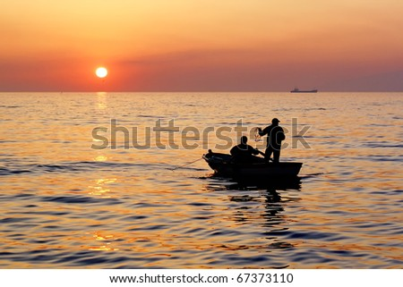Fisher boat on sunset