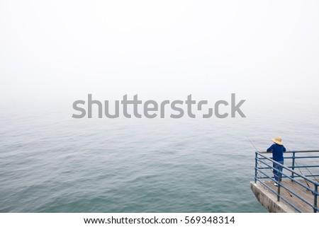 Fisher locking sea in Santa Monica Pier, Los Angeles, California.