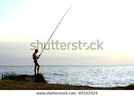 fisher silhouette on sunset background