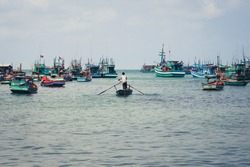 fisherman and fisher boats on ocean