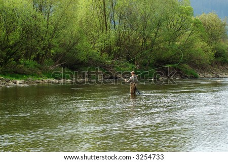 Fisherman angling on the river