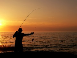 Fisherman at the dusk