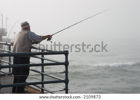 Fisherman at the Santa Monica Pier on a foggy day