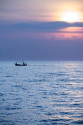fisherman boat in calm sea at sunrise in the morning
