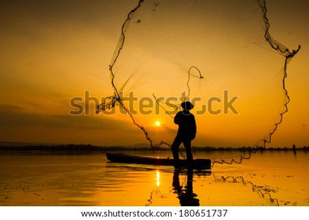 Fisherman casting his net at sunrise #180651737