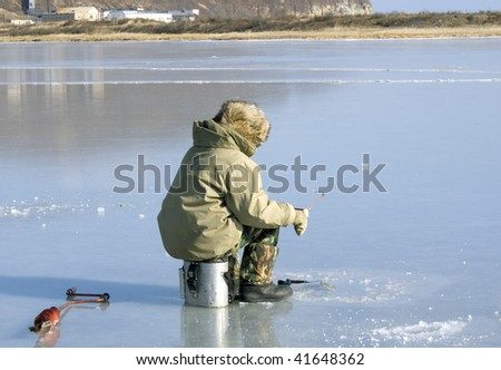 http://image.shutterstock.com/display_pic_with_logo/233851/233851,1259156764,9/stock-photo-fisherman-caughts-fishing-rod-fish-from-under-ice-41648362.jpg
