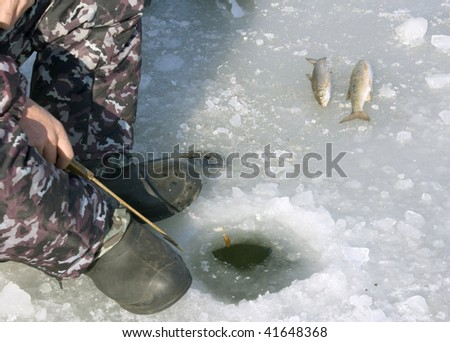 http://image.shutterstock.com/display_pic_with_logo/233851/233851,1259156863,1/stock-photo-fisherman-caughts-fishing-rod-fish-from-under-ice-41648368.jpg