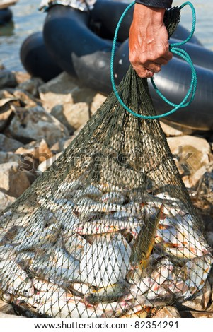 Fisherman hold net