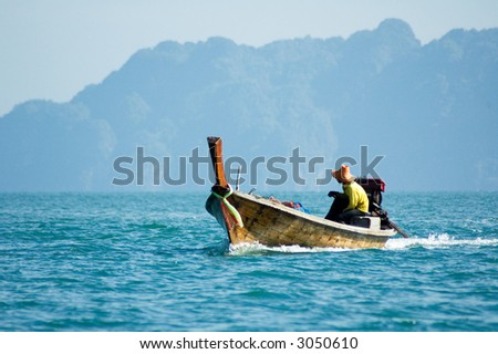 fisherman in a boat, koh lanta, thailand