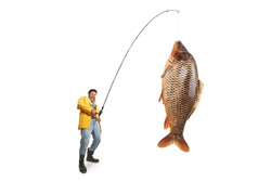 Fisherman in a yellow raincoat catching a big fish isolated on white background