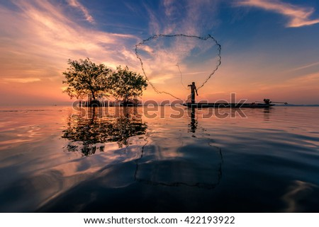 Fisherman in action when fishing in the lake ,Songkhla, Thailand #422193922
