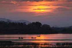 Fisherman in Arugam bay lagoon sunset, Sri Lanka