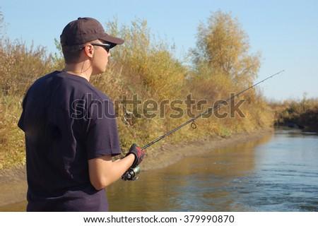 Fisherman in river #379990870